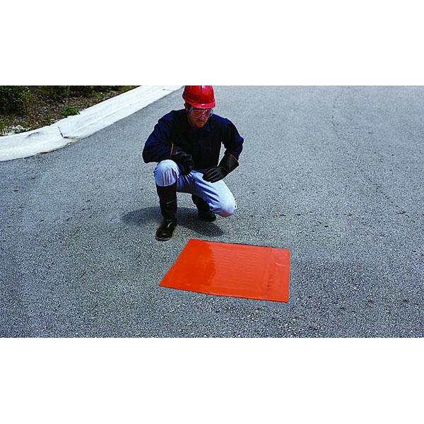 Man using Sellars 18 x 18 drain seal on street drain