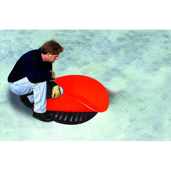 Man placing Sellars 42 inch drain seal over drain